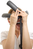 Stressed woman with phone receivers on white Royalty Free Stock Image