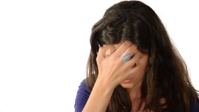 Stressed woman. Portrait of a stressed brunette girl looking at camera over white background stock video footage