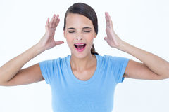 Stressed woman raising her hands around her head. On white background Royalty Free Stock Photo