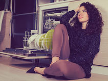 Stressed woman relaxing in the kitchen stock photo