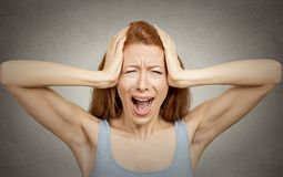 Stressed woman screaming Royalty Free Stock Image
