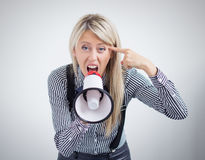 Stressed woman screaming on megaphone Stock Image