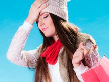 Stressed woman with shopping bag Royalty Free Stock Image