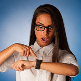 Stressed woman staring into watch gesturing being late Stock Images