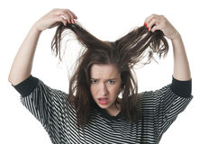 Stressed woman tearing her long hair up Royalty Free Stock Photography