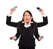 Stressed woman with telephones Royalty Free Stock Images