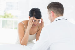 Stressed woman visiting doctor Royalty Free Stock Image