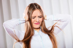 Stressed woman in white shirt with headache Stock Photo