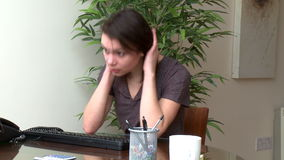 Stressed woman working at a computer stock video