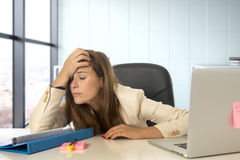 Stressed woman working with laptop computer on desk in overworked Royalty Free Stock Photography
