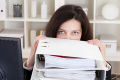 Stressed Woman Working In Office Royalty Free Stock Image
