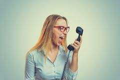 Stressed woman yelling in phone royalty free stock photography