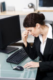 Stressed worker. Businesswoman showing signs of stress Royalty Free Stock Photography