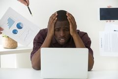 Stressed worker tired by too much work and annoying clients royalty free stock photo
