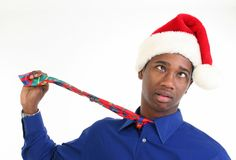 Stressed or Worried Man in Santa Hat Stock Images