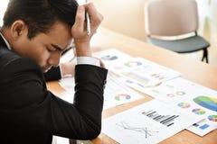 Businessman having headache. Royalty Free Stock Photo