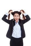 Stressed young Asian businesswoman is going crazy pulling her ha. Ir  isolated on white background Royalty Free Stock Photos