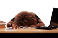 Stressed young black woman,  sitting at a table Stock Images