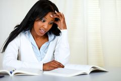 Stressed young black woman studying Stock Photo