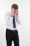 Stressed young business man and hands on head with bad headache Stock Photos