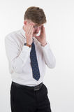 Stressed young business man and hands on head with bad headache Royalty Free Stock Images