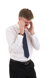 Stressed young business man and hands on head with bad headache Royalty Free Stock Photography
