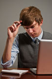 Stressed Young Business Man on Laptop Stock Images