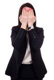 Stressed young business woman crying and covering her face isola Stock Photo