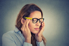 Stressed young business woman having headache. Portrait stressed young business woman having headache Stock Image