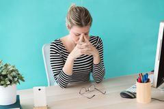 Stressed young business woman suffering anxiety while working in the office royalty free stock images