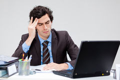 Stressed young businessman Stock Photo