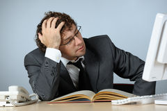 Stressed young businessman Stock Photography