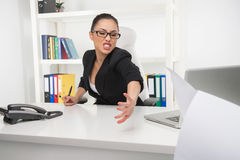 Stressed young businesswoman. Royalty Free Stock Photography
