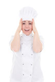 Stressed young cook woman isolated on white Royalty Free Stock Photo
