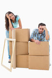 Stressed young couple with moving boxes Stock Photos