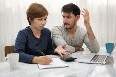 Young couple planning their montly expense. Stressed Young couple planning their montly expense royalty free stock photo