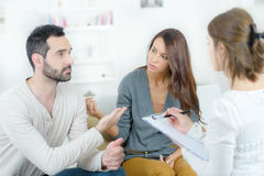 Stressed young couple quarrel at psychologist Stock Photography