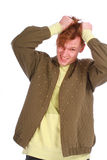 Stressed young guy tear his hair out Royalty Free Stock Photography