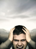 Stressed young man Stock Images