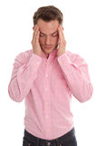 Stressed young man in pink with head in hands isolated on white Stock Images