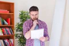 Man portrait and do it yourself furniture assembly stock image