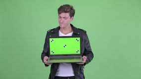 Stressed young rebellious man showing laptop stock video