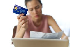 Stressed young sitting Asian girl worry about find money to pay credit card debt. royalty free stock photo
