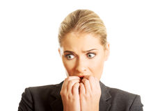 Stressed young woman biting her nails Royalty Free Stock Photography