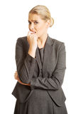 Stressed young woman biting her nails.  royalty free stock photography