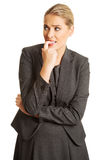 Stressed young woman biting her nails Royalty Free Stock Images
