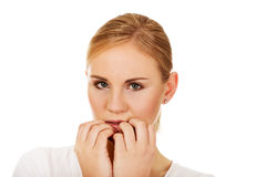 Stressed young woman biting nails Stock Photography