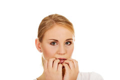 Stressed young woman biting nails Stock Image