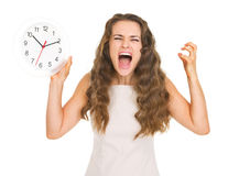 Stressed young woman with clock Royalty Free Stock Images
