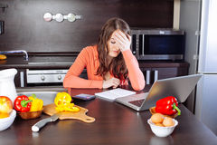 Stressed young woman is doing banking and administrative work ho Stock Photos